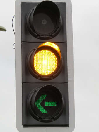 informing: Traffic Light informing drivers they can turn left. Stock Photo