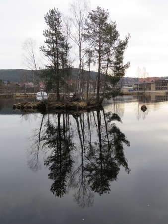 reflected: Trees reflected in the waters of a Norwegian river. Stock Photo