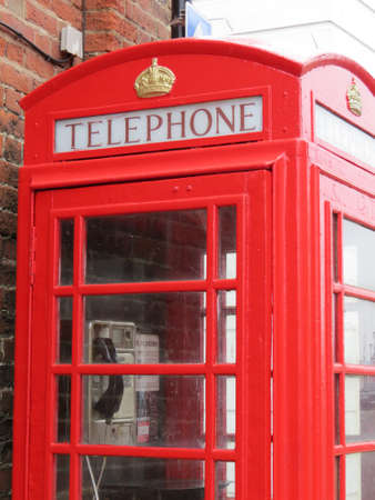 increased: Old style red UK phone box. These are becoming scarce due to the increased ownership of mobile phones.