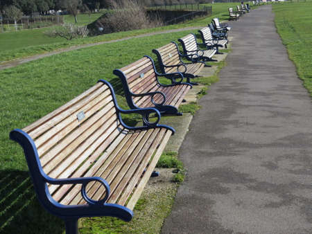 southsea: Row of benches on Southsea seafront. Each one has been bought by private individuals in memory of a loved one.