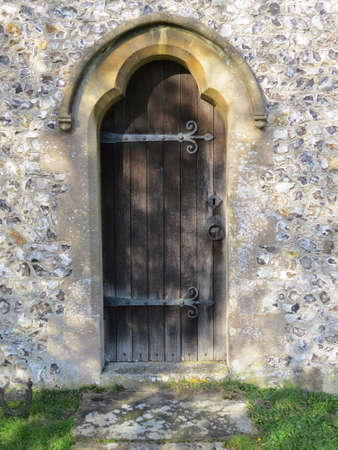 Doorway of the church in the Hampshire village of East Meon, UK.
