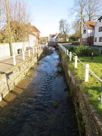 Stream running through the Hampshire village of East Meon, UK.