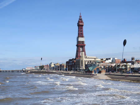 seafronts: Blackpool tower, a famous landmark opposite the Golden Mile promenade in Blackpool.