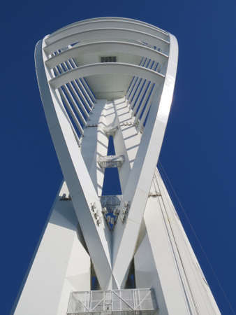 observations: Close up of the Spinnaker Tower. The Spinnaker Tower is a well known Portsmouth landmark. Originally to be called the Millennium Tower, the name was changed due to construction delays preventing its completion by the year 2000.