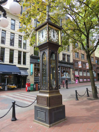 Steam clock located in Gastown, Vancouver, Canada. The clock is powered by steam and plays a tune from the pipes on top every hour.