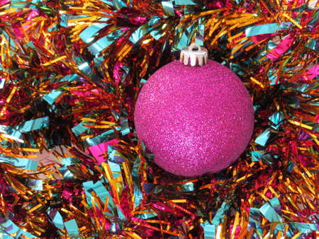 amongst: Christmas tree decoration amongst some tinsel.