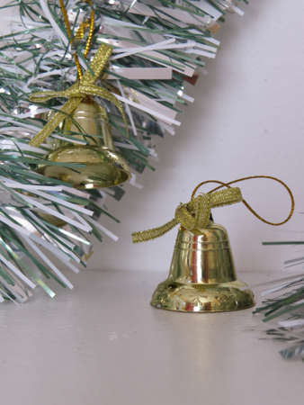 the tinsel: Christmas decorations amongst some tinsel. Stock Photo