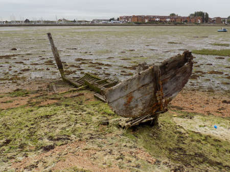 disrepair: Remnants of an old boat in Langstone harbour Portsmouth UK.  Stock Photo