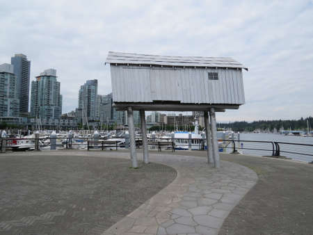 Shed on stilts on the harbour front in Vancouver Canada. Unsure why this been placed several feel up in the air