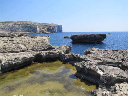 rock arch: The Azure Window area in the Maltese island of Gozo is a small stretch of coastline consisting of rock formations, tidal pools and a large rock arch forming a window - hence the areas name.