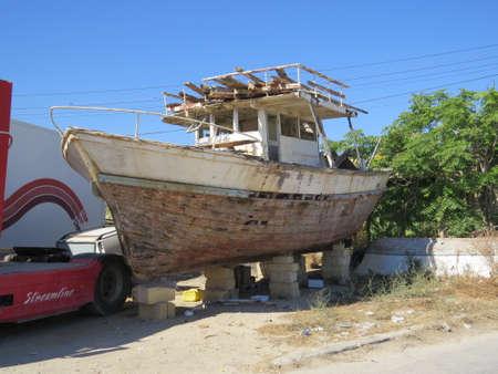 dockside: Old boat decaying on a dockside in Valletta, Malta.