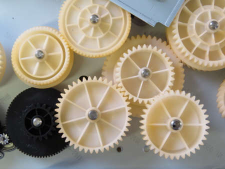 gear wheels: Gear wheels which control  the operation of a computer printer. Stock Photo