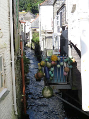 floats: Floats hanging on a balcony in the Cornish fishing village of Polpero.