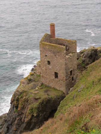 cornwall: Engine house ruins of the Crown tin mine near the town of St Just in Cornwall, UK. Stock Photo