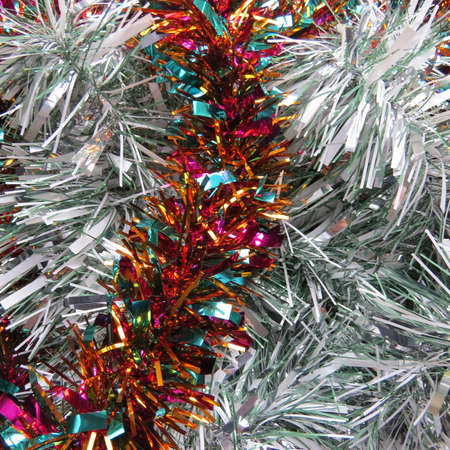 the tinsel: Background of different coloured Christmas tinsel.