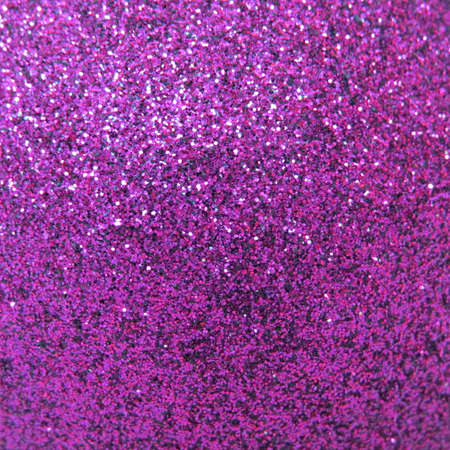twinkles: Close up of a Christmas bauble covered with glitter.