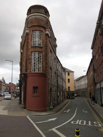 junction: Unusual shaped building on a road junction in Cork, Ireland.