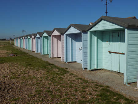 Row of brightly coloured beach huts on Southsea seafront.