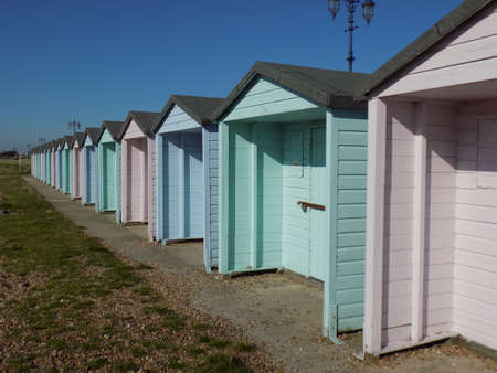 southsea: Row of brightly coloured beach huts on Southsea seafront.