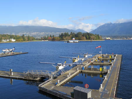 Seaplanes are used to transport passengers between Vancouver City and Vancouver Island, Canada. Редакционное
