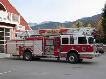 no snow: Whistler, Canada - October 24th, 2015: Fire engine outside the fire station in Whistler. Although a well known Winter ski resort, when theres no snow on the ground fires in the surrounding forest are not uncommon.