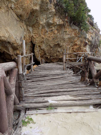 rickety: Rickety wooden bridge leading to a beach on Koh Larn Island in Thailand.
