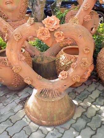 terracotta: Roses made from terracotta on a terracotta heart shaped log.