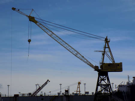 dockyard: Dockyard crane used on the North shore of Vancouver, Canada. Stock Photo