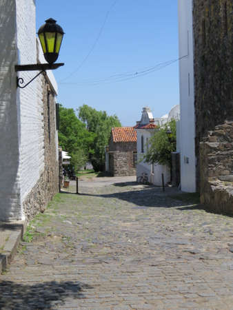 One of the old cobblestone streets in the Uruguayan town of Colonia de Sacramento. Imagens - 49648189