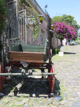 Old cart on a cobblestone street in the town of Colonia de Sacramento, Uruguay. Imagens