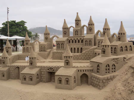 inclement: Sand sculpture on Copacabana beach in Rio De Janeiro, Brazil. These have to be remade every few days due to destruction by the sea and inclement weather.