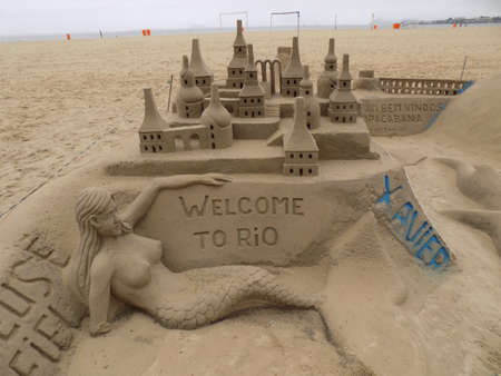 inclement weather: Sand sculpture on Copacabana beach in Rio De Janeiro, Brazil. These have to be remade every few days due to destruction by the sea and inclement weather.