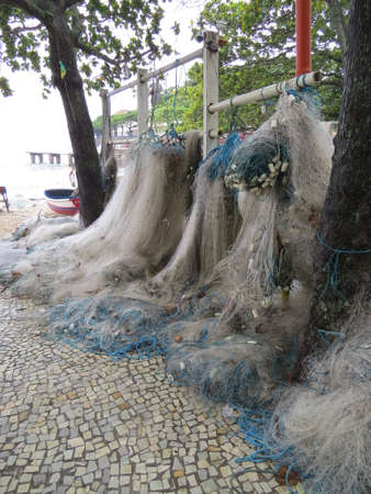 janeiro: Fishing nets drying on Copacabana beach in Rio De Janeiro, Brazil.
