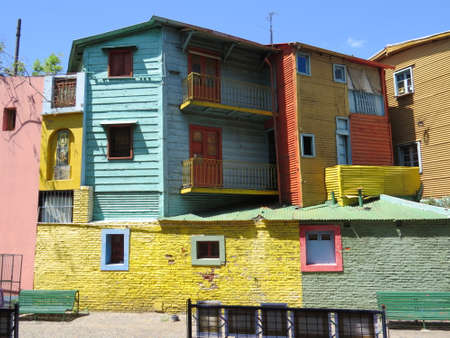brightly: Calle Caminito is an area of Buenos Aries known for its brightly painted houses.