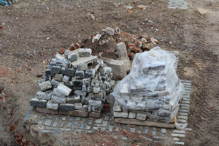 cobblestones: Used cobblestones stacked on a pallet ready to be recycled. Stock Photo