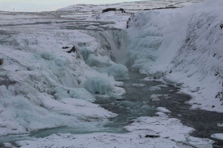 dramatically: Gullfoss waterfall is the largest in Iceland. The flow has been dramatically reduced due to freezing.
