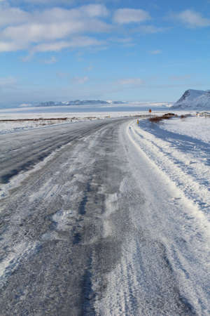 ice covered: Ice covered road in the Icelandic countryside.