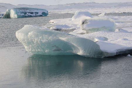icebergs: Jokulsarlon glacier lagoon. This is where icebergs break from the glacier before floating out to sea. Stock Photo