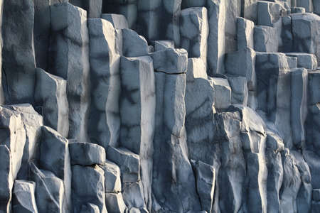 laborers: Background of some basalt rock columns. Stock Photo