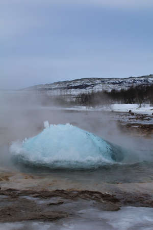 swelling: Water swelling up in an Icelandic geyser just before it errupts. Stock Photo