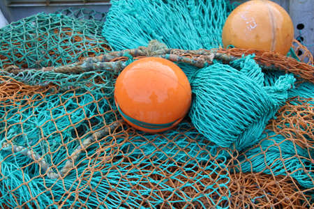 dockside: Fishing nets on the dockside in Old Portsmouth. Stock Photo
