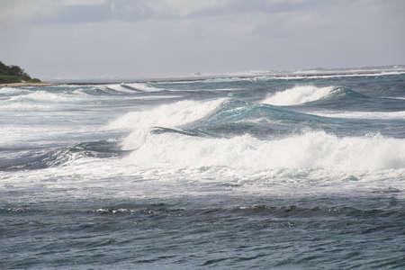 braking: Waves braking off the coast of the isle of Mauritius. Stock Photo
