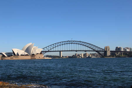 Sydney Opera House with the Sydney Harbour Bridge in the background.