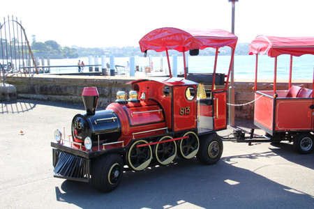 terminating: Sydney, Australia - April 27th, 2016: Tourist train which travels along the length of Farm Cove on Sydneys waterfront terminating close to the famous opera house.