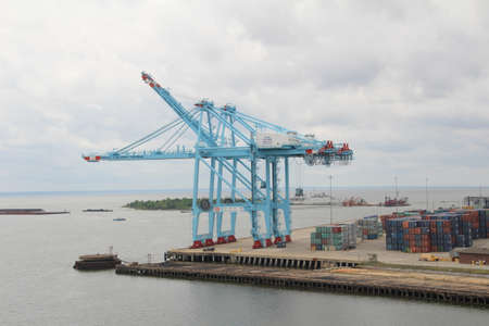 Mobile, USA - May 17th, 2016: Dockyard crane in the port of Mobile, Alabama. This is used to offload some of the thousands of shipping containers which pass through the port every week. Editorial