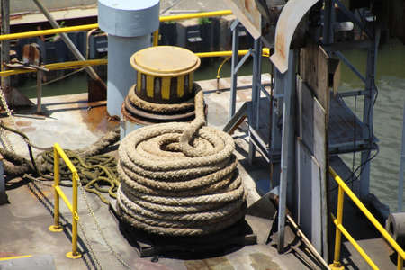 coiled rope: Capstan and coiled rope on a dry dock in Mobile, Alabama. Editorial