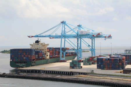 dockyard: Ship being unloaded by dockyard cranes in Mobile, Alabama.