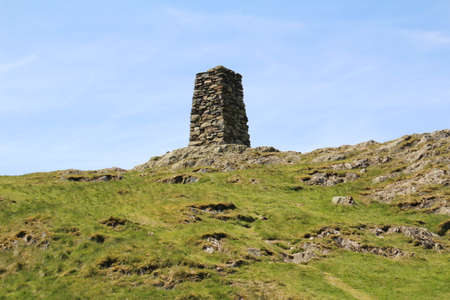 cumbria: Triangulation (Trig) point on the top of one of the many peaks in the Lake District in Cumbria, UK.