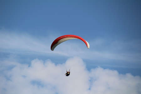hang glider: Hang glider in the blue skies above the Lake District.