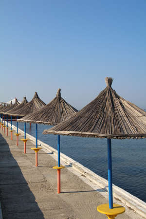 seafronts: Parasols along the seafront in Durres, Albania.